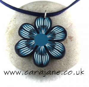 Striking polymer Clay flower pendant