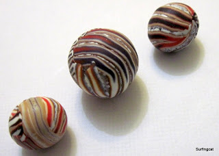 Brown Stripey beads made using an extruder technique by Cara Jane
