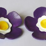 Purple plastic flower brooches