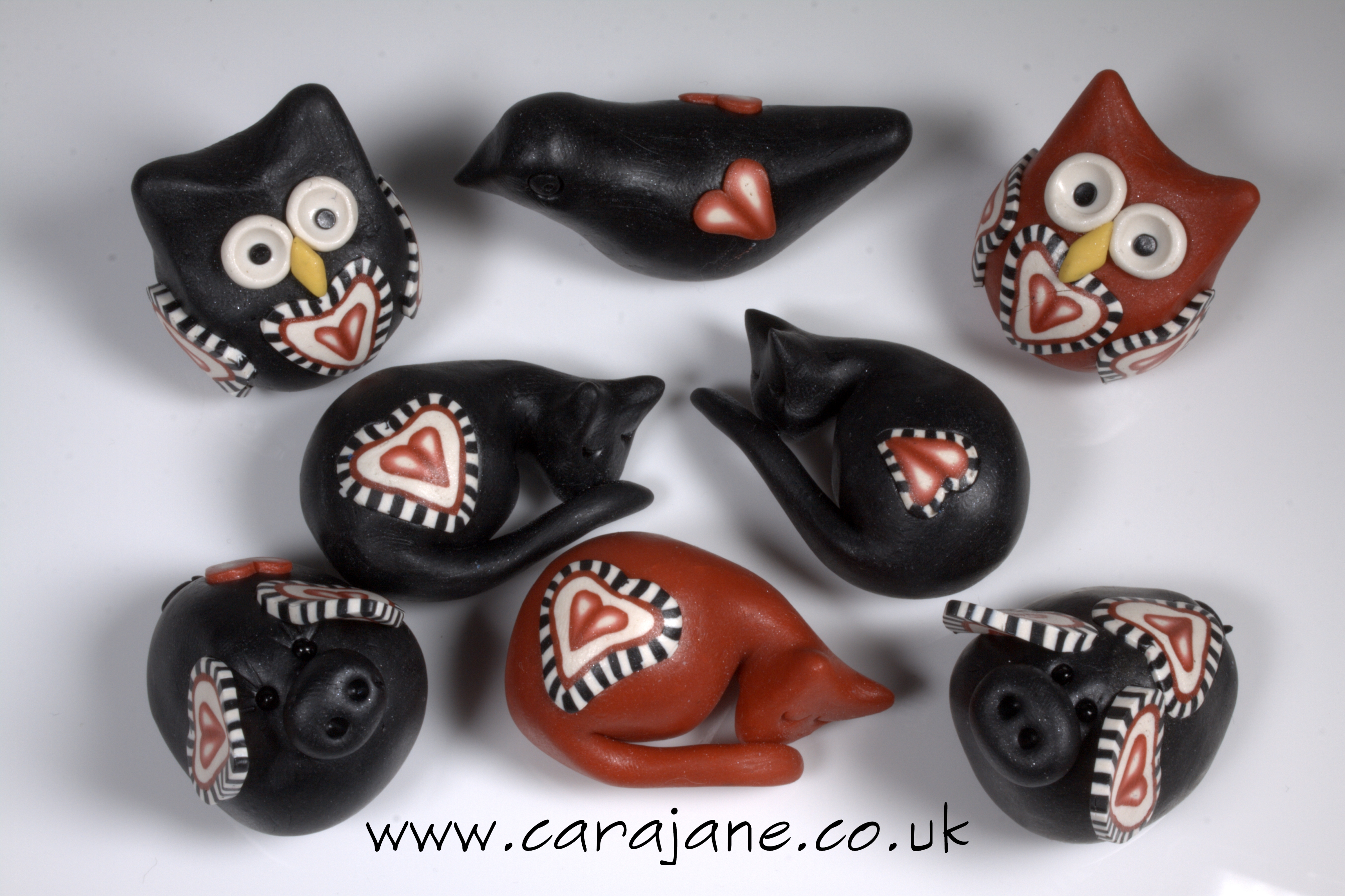 polymer clay creatures with hearts