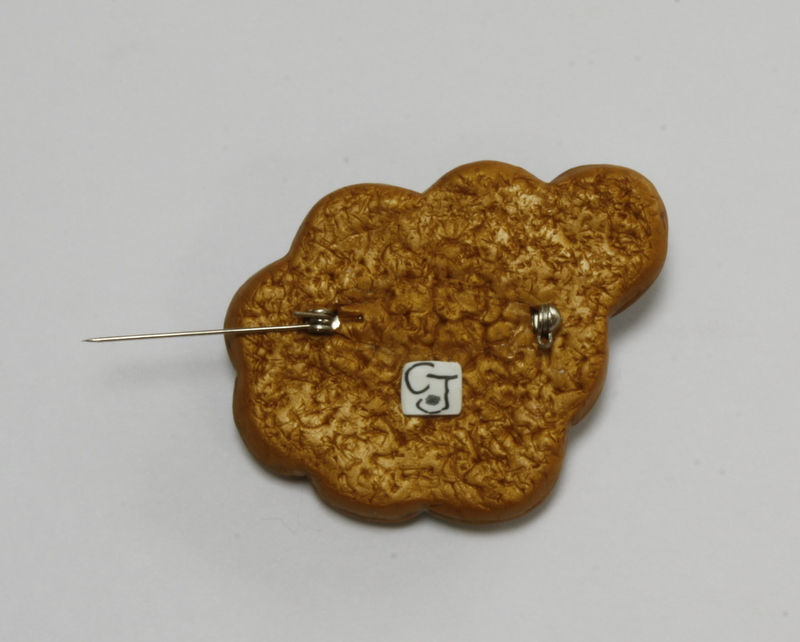 Back of brooch showing how the back is made neat with polymer