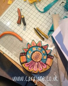 Cara Jane Polymer clay Colourful Cane in construction